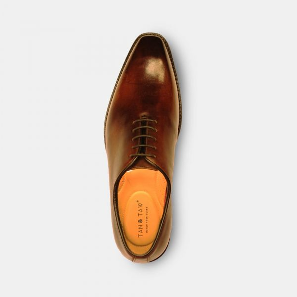 wholecut oxford shoes in grey plain background