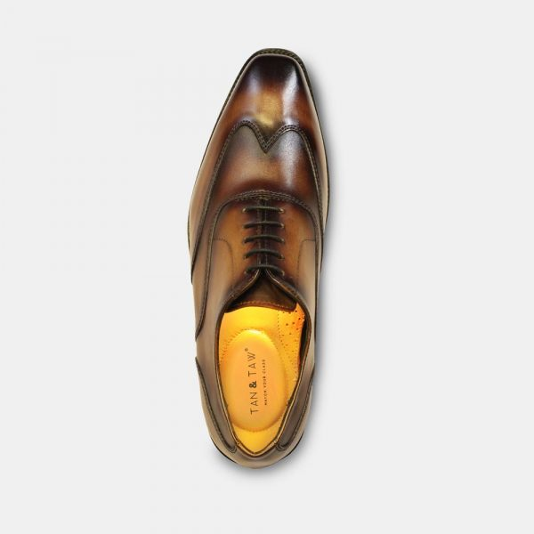 leather oxford shoes tan color in grey plain background