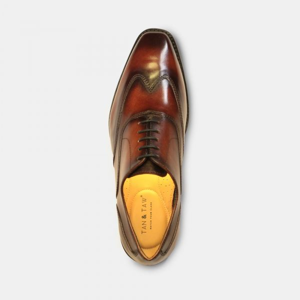 oxford style shoes red color in grey plain background