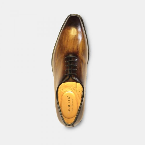 wholecut shoes with wooden color in greay plain background