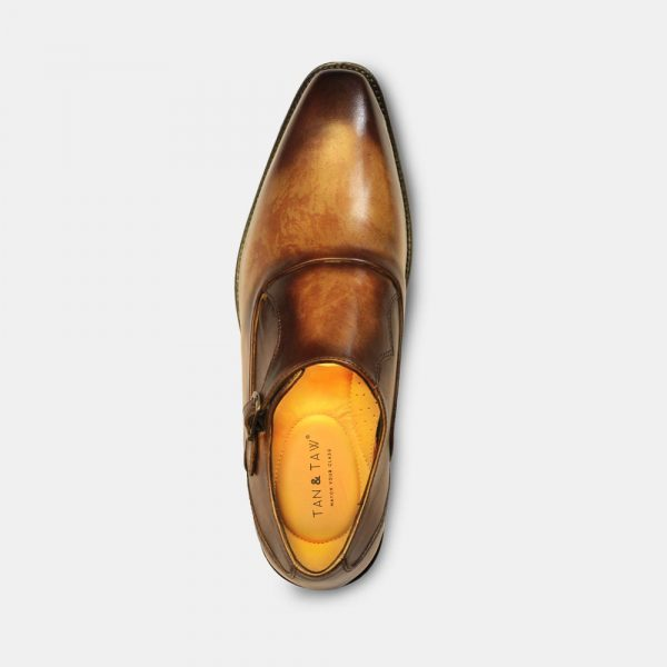 mens monk strap shoes in plain grey background