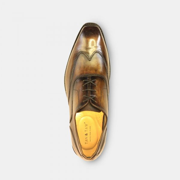 oxford shoes men tan color in gray plain background