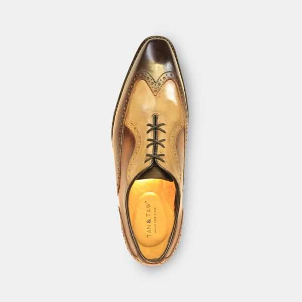 brogues tan color in grey plain background